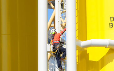 engineer-climbs-offshore-wind-turbine-370x229